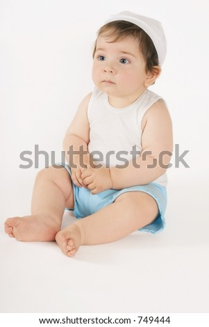 Sitting nine month old baby on white background.