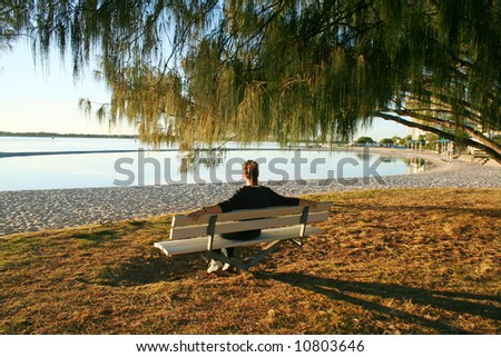 Sitting on a bench by the water just after dawn.