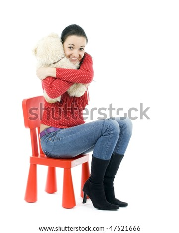 sitting on child's plastic red hair woman hugging teddybear