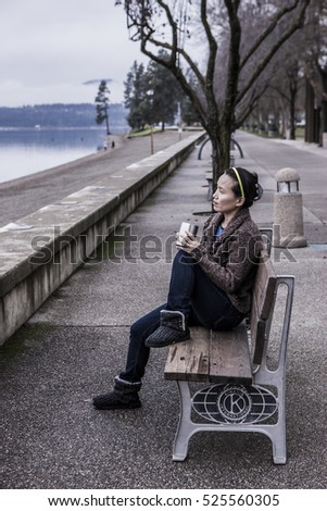 Sitting on park bench with her coffee in Coeur d'Alene, Idaho.