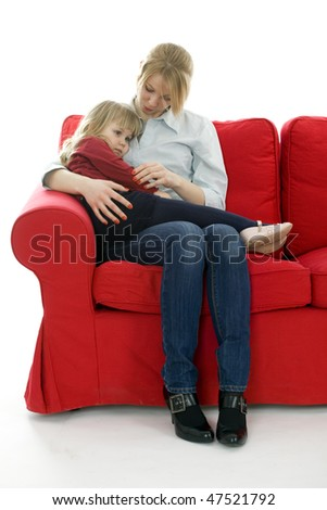 sitting on red sofa young woman keeping on knees child - stock photo