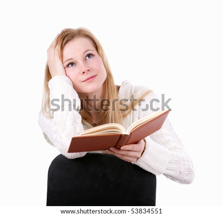 sitting on the chair young woman reading book - stock photo