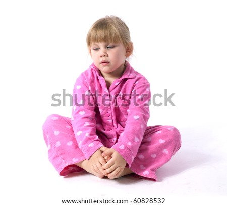sitting on the floor little girl in pink pajamas - stock photo
