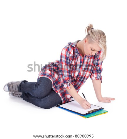 sitting on the floor young woman writing on clipboard