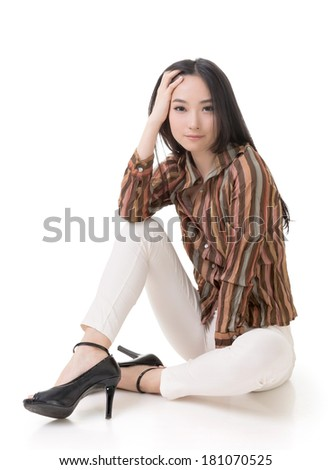 Sitting pose by sexy Asian beauty, full length portrait isolated on white.