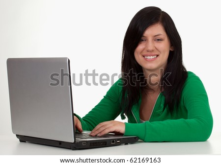 sitting smiling young long hair woman in green blouse with laptop