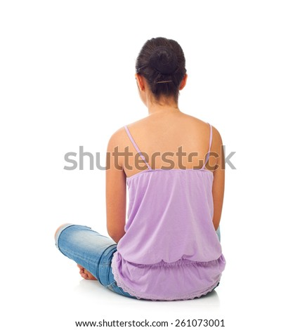 Sitting teenage girl from behind on white background - stock photo