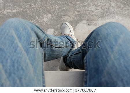 Sitting top view with blue jean - stock photo