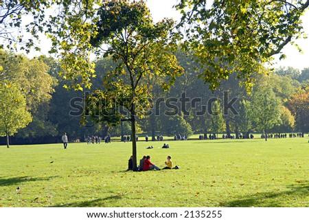 sitting under a tree - stock photo