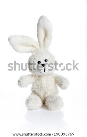 Sitting white stuffed bunny - stock photo