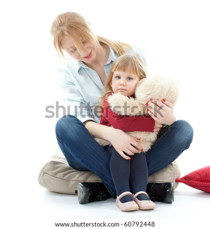 sitting with mother little girl hugging teddy - stock photo