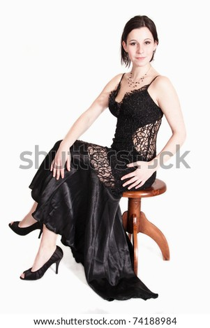 sitting woman in evening dress - stock photo