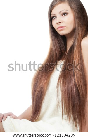 sitting woman portrait with long shiny hair over white