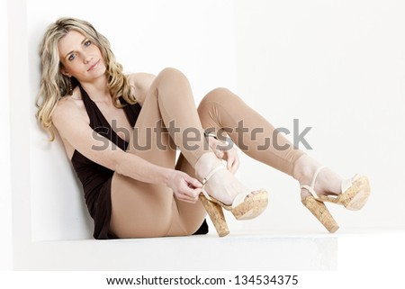 sitting woman wearing summer clothes and shoes - stock photo