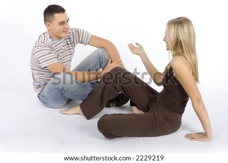 sitting young woman and man having a conversation - stock photo