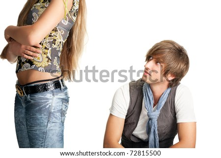 sittng men looks at woman bottom - stock photo