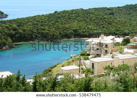 Sivota, GREECE, May 09, 2013: View of blue bay with green hills and yachts in the Ionian Sea in Greece.