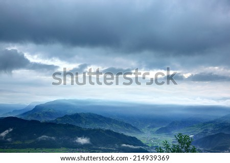 Siwaliks in Pokhara velley and glimpse of higher himalayan range - stock photo