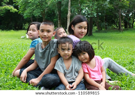 Six asian kids having a good time in the park.