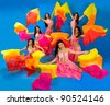 Six beautiful girls in Arab costumes on blue background - stock photo