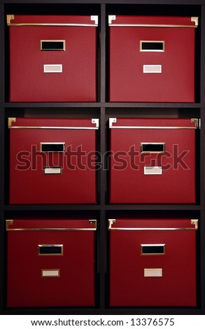 Six Big archive red boxes on black wooden shelf - stock photo