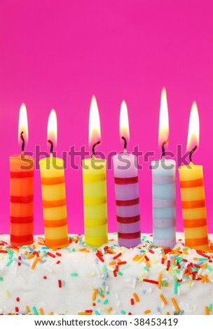Six birthday candles on pink background