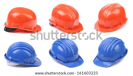 Six blue and red hard hats. On a white background - stock photo
