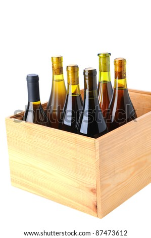 Six bottles of Chardonnay wine Standing up in a wooden case over a white background - stock photo