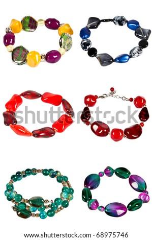 six bright colourful braceletes isolated on white - stock photo