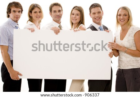 Six business men and women holding a big blank sign - stock photo