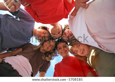 Six Children Touching Heads Looking Very Happy - stock photo