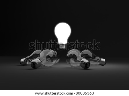 Six clear light bulbs in a circle, one illuminated standing out from the group - stock photo