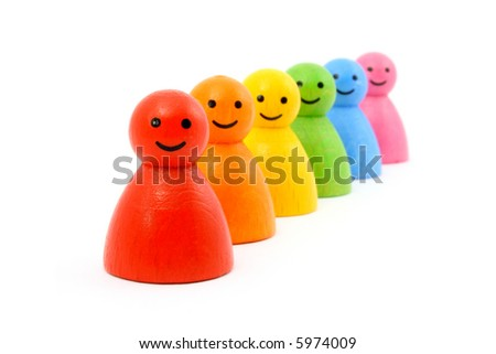 Six colorful gaming pieces smiling. Isolated on white. - stock photo