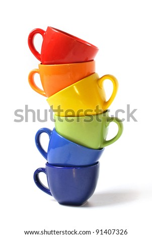 Six colorful teacups - stock photo