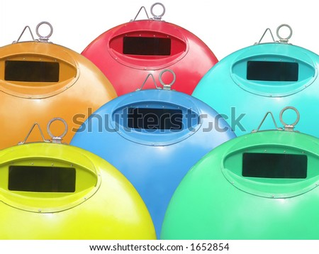 Six colorful waste bins - stock photo