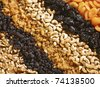 Six diagonal rows of assorted dried fruit and nuts - stock photo