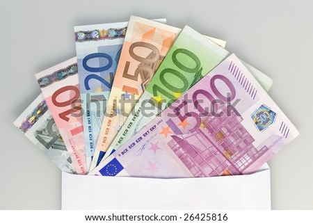 Six different Euro notes sticking out of a white envelope, grey background