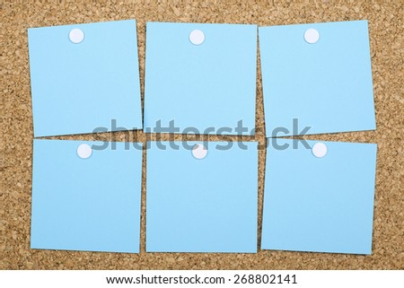 Six Empty Blue Adhesive Note Papers Pinned On Cork Bulletin Board - stock photo