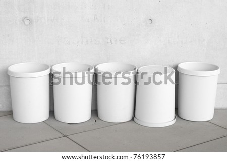 Six Empty Trash Cans as Recycling  Symbols - stock photo