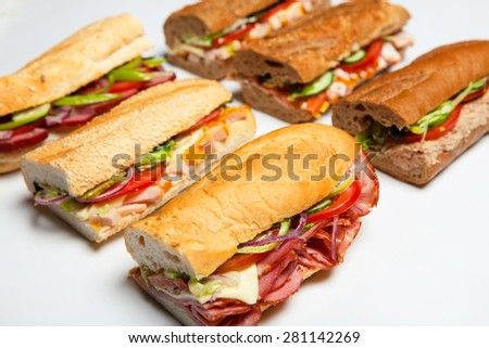 Six fresh sandwiches.Assorted delicious baguette sandwiches - stock photo