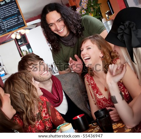 Six friends having a good time at a cafe - stock photo