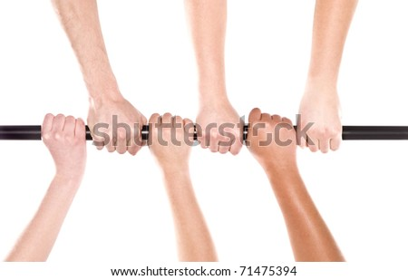 Six human hands holding the same stick - stock photo