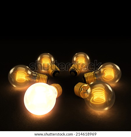 Six illuminated incandescent light bulbs in a circle on a dark background with one brighter - stock photo