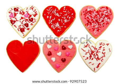 Six individual heart-shaped cookies for Valentines Day over white - stock photo