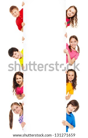 Six kids, boys and girls showing blank white board for advertising to be inserted, isolated on white - stock photo