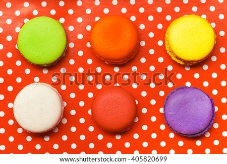 Six macarons laying on red polka-dot tray - stock photo