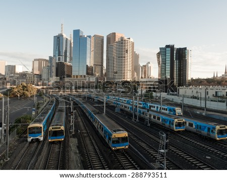 six melbourne trains heading into or out of the city centre - stock photo