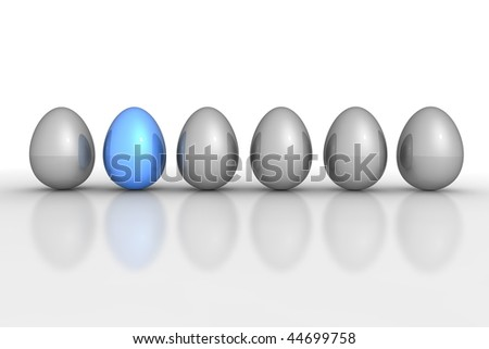 six metallic eggs ordered in a line - five eggs grey, one egg blue