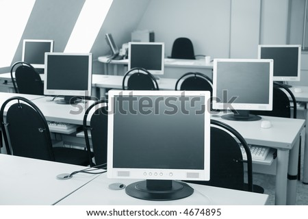 six monitors in a computer class - stock photo