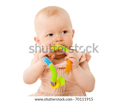 Six month Baby chewing toy isolated on white